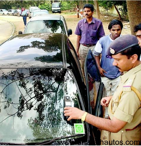 Police checks the visibility of tinted glass of a car using a light meter on one of Delhis roads