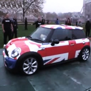 28 women cram into a new Mini Cooper