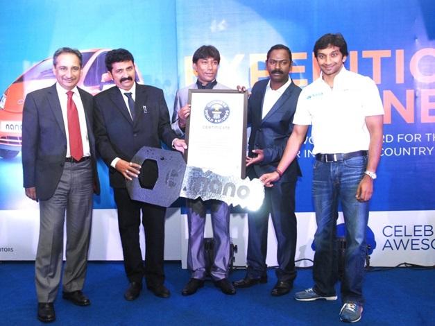 Narain Karthikeyan and Ranjit Yadav (left), President, Passenger vehicle business unit, Tata Motors, felicitating Mr. Srikarunya Subrahmanyam and his team.