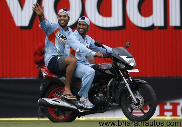 Yuvraj Singh and Mahendra Singh Dhoni ride bike which was given to Yuvraj Singh for winning the man-of-the-match award in Indore