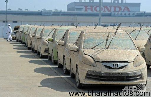 Honda begins scrapping over 1400 cars damaged during recent Thai floods
