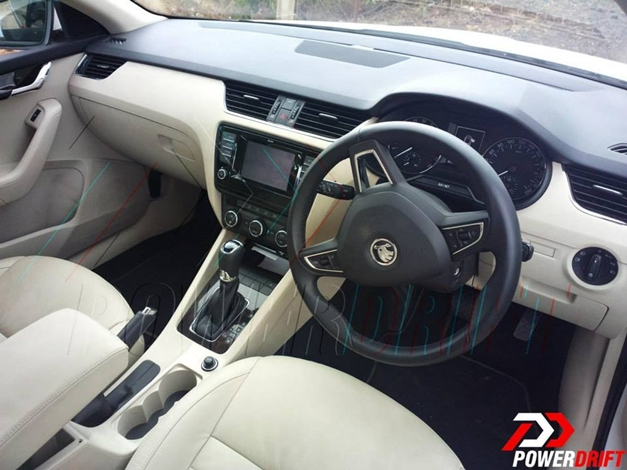 spy shots a clearer view of india spec 2013 skoda octavia interior revealed. Black Bedroom Furniture Sets. Home Design Ideas