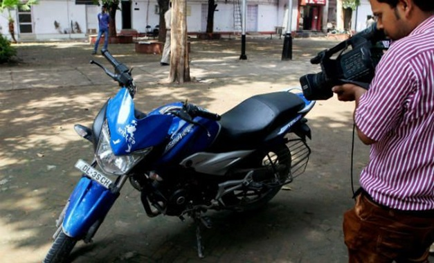 Motorcycle of the 19-yr-old, who was shot dead by a police firing at Windsor place in New Delhi on Sunday - PTI