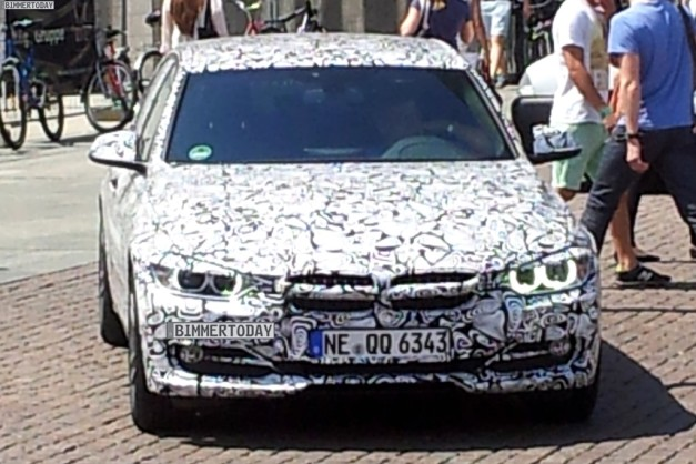 Jaguar-XE-promoted-by-camouflaged-BMW-car-front-view