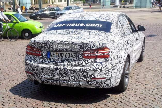 Jaguar-XE-promoted-by-camouflaged-BMW-car-rear-view