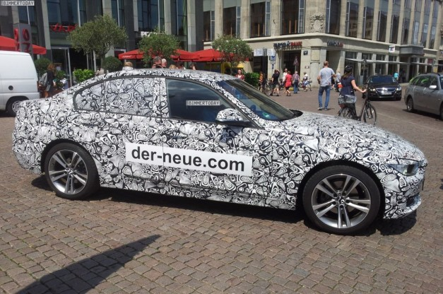 Jaguar-XE-promoted-by-camouflaged-side-view