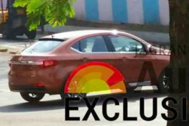 tata-tigor-sedan-sunburst-orange-rear-back-pictures-photos-images-snaps